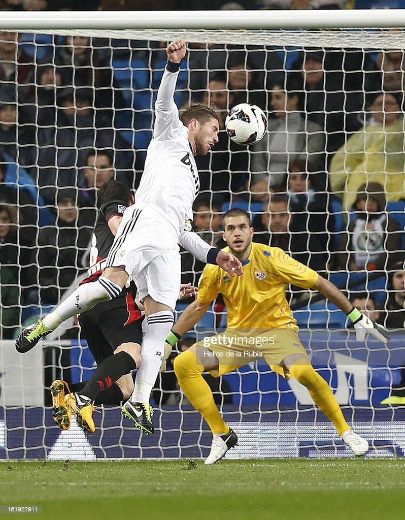 Sergio Ramos of Real Madrid heads the ball to score his team's second goal past goalkeeper Ruben Martinez of Rayo Vallecano during the La Liga match between Real Madrid and Rayo Vallecano at Estadio Santiago Bernabeu on February 17, 2013 in Madrid, Spain.