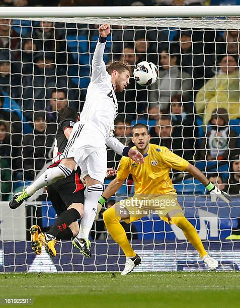 Sergio Ramos of Real Madrid heads the ball to score his team's second goal past goalkeeper Ruben Martinez of Rayo Vallecano during the La Liga match...