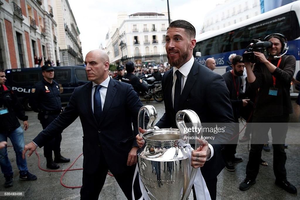Sergio Ramos of Real Madrid holds the troph during their visit to President of the Community of Madrid Cristina Cifuentes after Real Madrid won the UEFA Champions League Final match against Club Atletico de Madrid, at Madrid City Hall in Madrid, Spain on May 29, 2016.