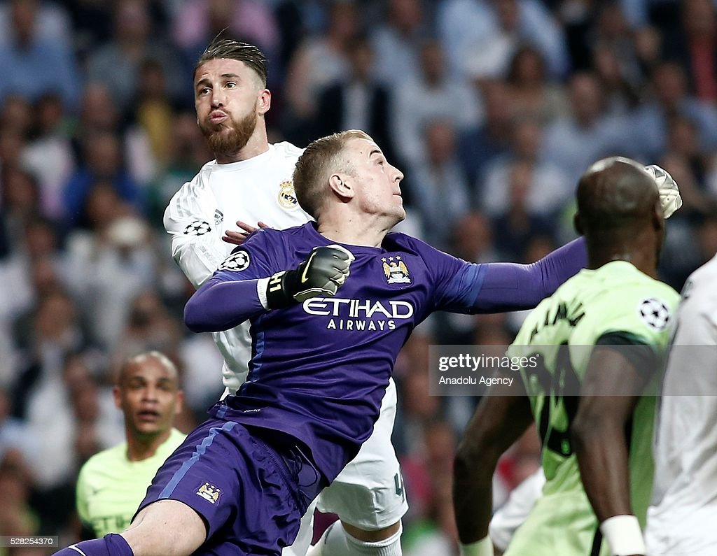 Sergio Ramos (Rear) of Real Madrid in action against Joe Hart of Manchester City during the UEFA Champions League semi-final second leg football match between Real Madrid and Manchester City at the Santiago Bernabeu Stadium in Madrid, Spain on May 4, 2016.