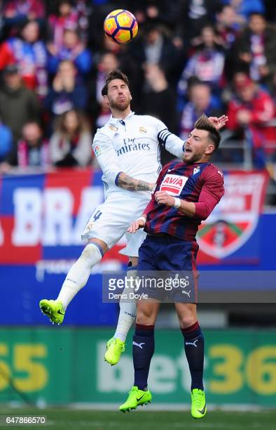 Sergio Ramos of Real Madrid in action against Sergi Enrich of SD Eibar during the La Liga match between SD Eibar and Real Madrid CF at Estadio...