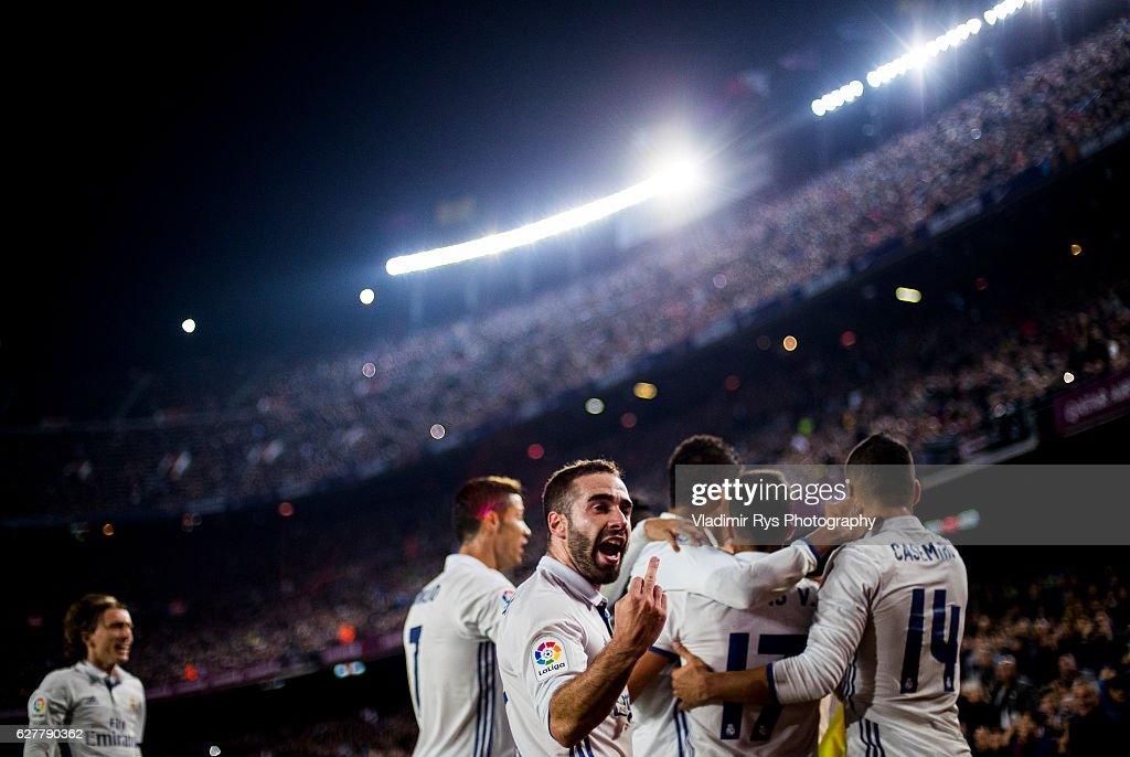 Sergio Ramos of Real Madrid is celebrated by his team after scoring the 1:1 goal as his team mate Daniel Carvajal gestures towards the fans during the La Liga match between FC Barcelona and Real Madrid CF at Camp Nou stadium on December 03, 2016 in Barcelona, Spain.