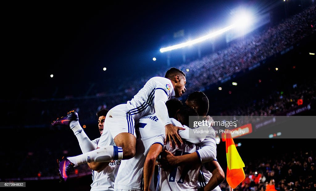 Sergio Ramos of Real Madrid is celebrated by his team mates after scoring the 11 goal during the La Liga match between FC Barcelona and Real Madrid...