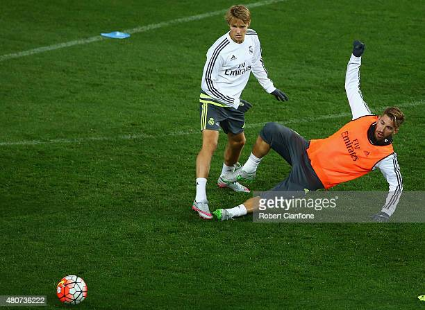 Sergio Ramos of Real Madrid is challenged by Martin Odegaard during Real Madrid training session at Melbourne Cricket Ground on July 15 2015 in...