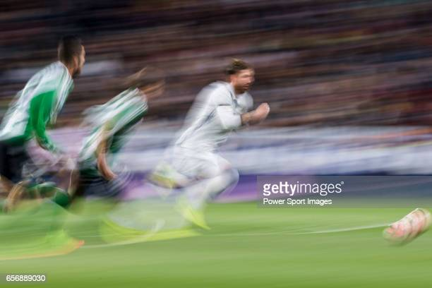 Sergio Ramos of Real Madrid is followed by Real Betis' players during their La Liga match between Real Madrid and Real Betis at the Santiago Bernabeu...