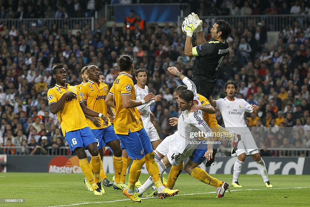 Sergio Ramos of Real Madrid is fouled in the penalty area by Giorgio Chiellin of Juventus during the UEFA Champions League Group B match between Real Madrid and Juventus at Estadio Santiago Bernabeu on October 23, 2013 in Madrid, Spain.