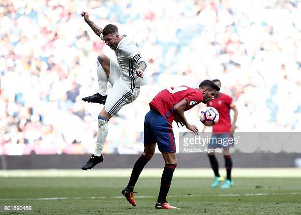 Sergio Ramos of Real Madrid is in action against Kenan Kodro of CA Osasuna during the Spanish first league La Liga soccer match between Real Madrid...