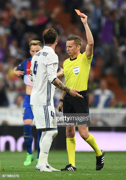 Sergio Ramos of Real Madrid is sent off by referee Alejandro Jose Hernandez Hernandez after a foul on Lionel Messi of Barcelona during the La Liga...