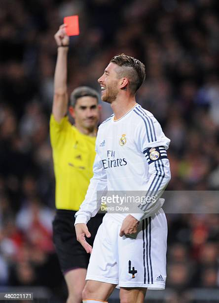 Sergio Ramos of Real Madrid is shown the red card by referee Alberto Undiano Mallenco during the La Liga match between Real Madrid CF and FC...