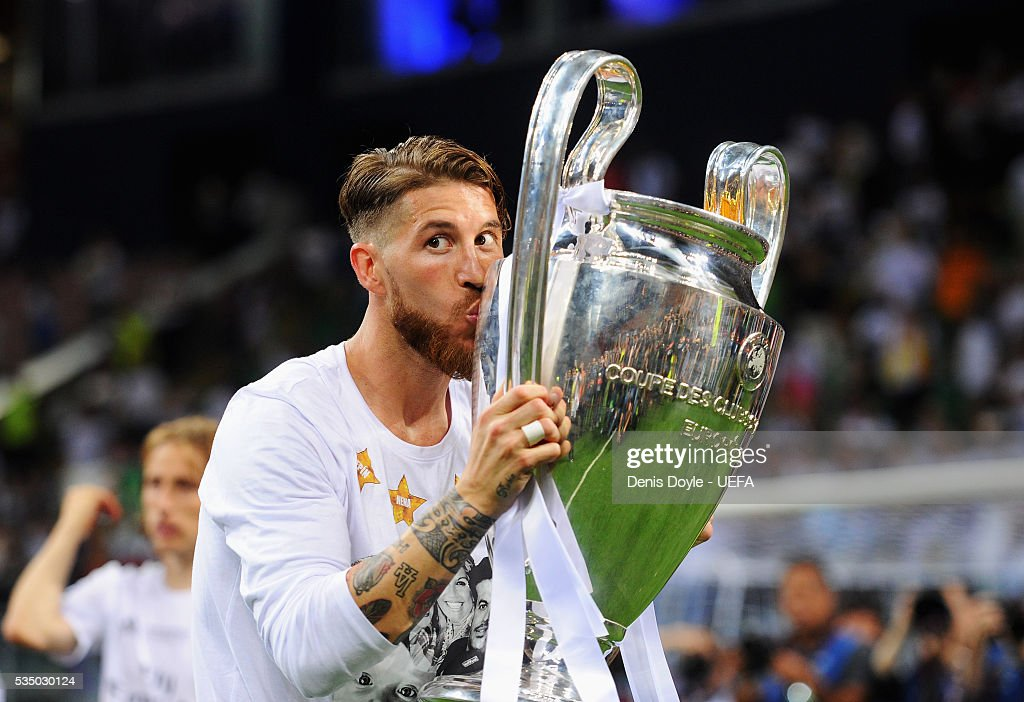 Sergio Ramos of Real Madrid kisses the Champions League Trophy after the UEFA Champions League Final between Real Madrid and Club Atletico de Madrid at Stadio Giuseppe Meazza on May 28, 2016 in Milan, Italy.