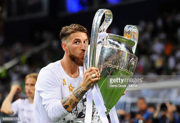 Sergio Ramos of Real Madrid kisses the Champions League Trophy after the UEFA Champions League Final between Real Madrid and Club Atletico de Madrid...