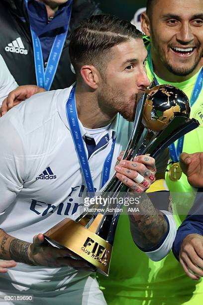Sergio Ramos of Real Madrid kisses the trophy at the end of the FIFA Club World Cup final match between Real Madrid and Kashima Antlers at...