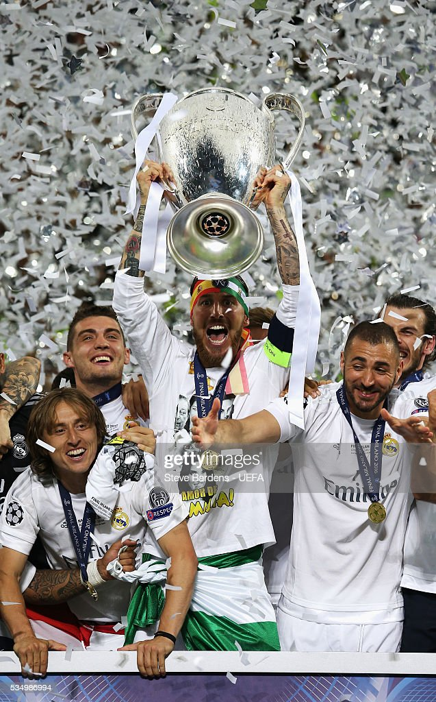 Sergio Ramos of Real Madrid lifts the Champions League Trophy at the ceremony after the UEFA Champions League Final between Real Madrid and Club Atletico de Madrid at Stadio Giuseppe Meazza on May 28, 2016 in Milan, Italy.