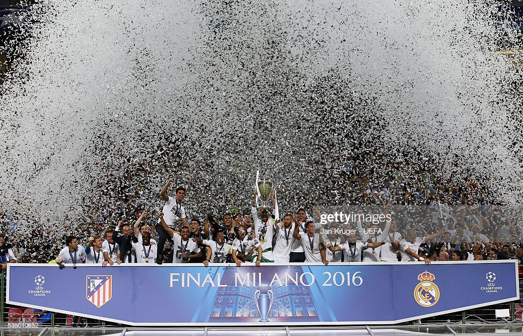 Sergio Ramos of Real Madrid lifts the trophy after the UEFA Champions League Final between Real Madrid and Club Atletico de Madrid at Stadio Giuseppe Meazza on May 28, 2016 in Milan, Italy.