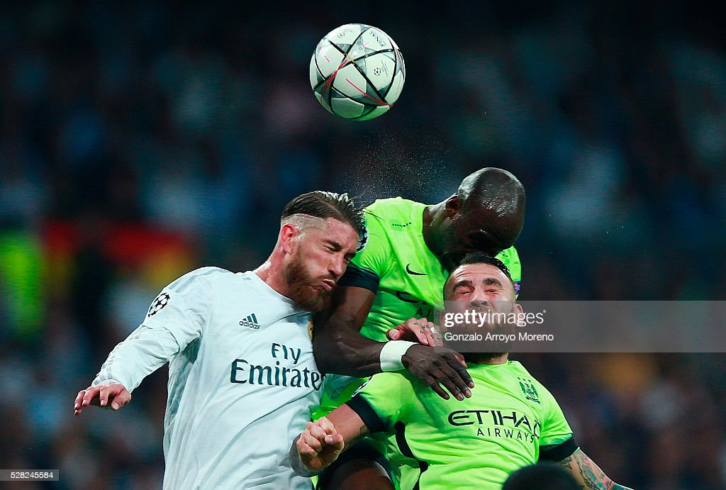 Sergio Ramos of Real Madrid, <a gi-track='captionPersonalityLinkClicked' href=/galleries/search?phrase=Nicolas+Otamendi&family=editorial&specificpeople=5863368 ng-click='$event.stopPropagation()'>Nicolas Otamendi</a> of Manchester City and <a gi-track='captionPersonalityLinkClicked' href=/galleries/search?phrase=Eliaquim+Mangala&family=editorial&specificpeople=5713850 ng-click='$event.stopPropagation()'>Eliaquim Mangala</a> of Manchester City battle to win a header during the UEFA Champions League semi final, second leg match between Real Madrid and Manchester City FC at Estadio Santiago Bernabeu on May 4, 2016 in Madrid, Spain.