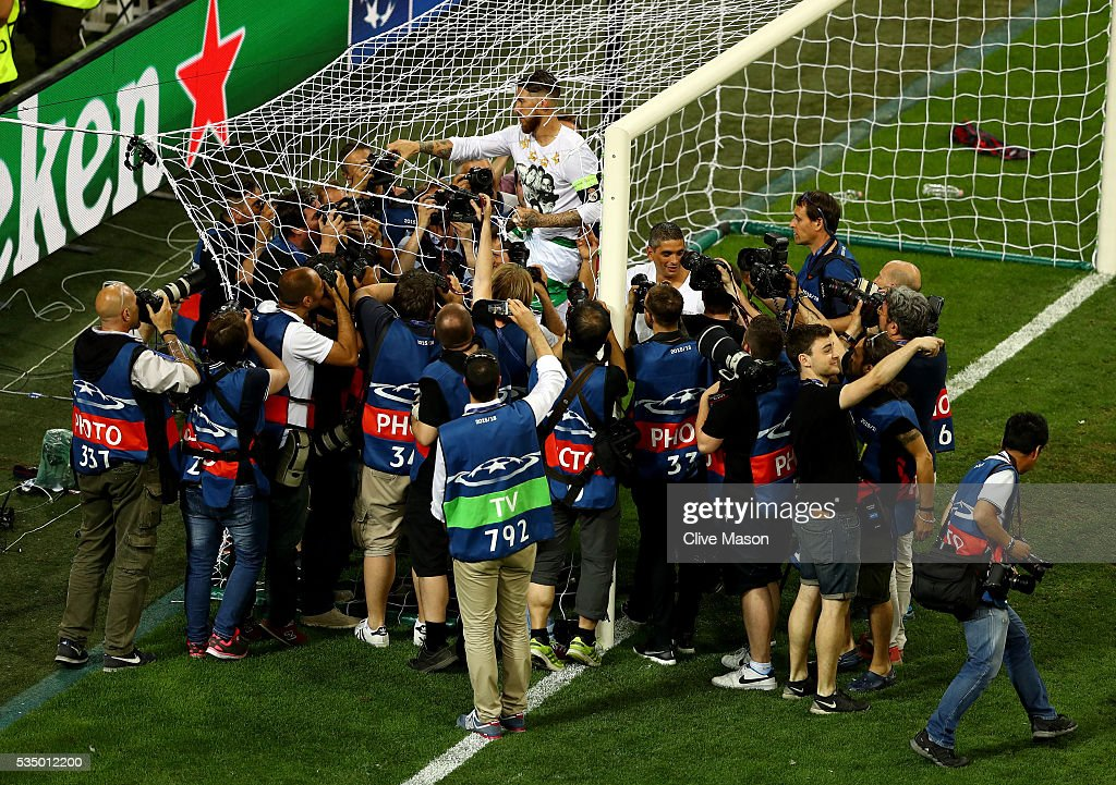 Sergio Ramos of Real Madrid of Real Madrid cuts the net after the UEFA Champions League Final match between Real Madrid and Club Atletico de Madrid at Stadio Giuseppe Meazza on May 28, 2016 in Milan, Italy.
