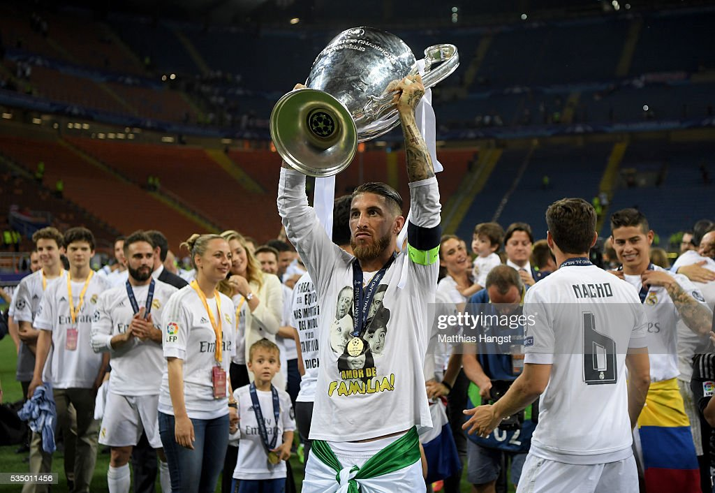 Sergio Ramos of Real Madrid of Real Madrid lifts the Champions League trophy after the UEFA Champions League Final match between Real Madrid and Club Atletico de Madrid at Stadio Giuseppe Meazza on May 28, 2016 in Milan, Italy.
