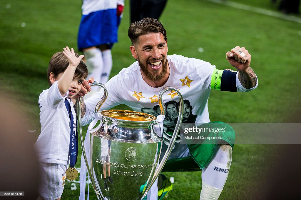 Sergio Ramos of Real Madrid poses for a photo with his son during the UEFA Champions League Final between Real Madrid and Atletico Madrid at Stadio Giuseppe Meazza on May 28, 2016 in Milan, Italy.
