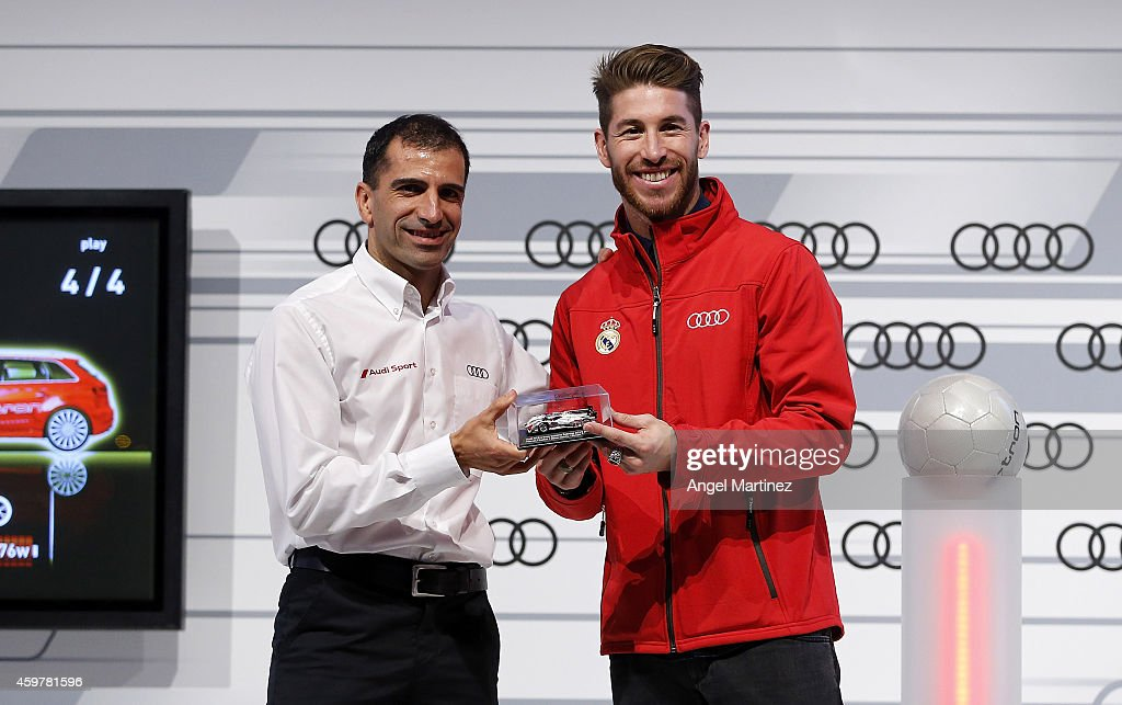 Sergio Ramos (R) of Real Madrid poses with <a gi-track='captionPersonalityLinkClicked' href=/galleries/search?phrase=Marc+Gene&family=editorial&specificpeople=217824 ng-click='$event.stopPropagation()'>Marc Gene</a> during the car handover of Audi at Ciudad Real Madrid on December 1, 2014 in Madrid, Spain.