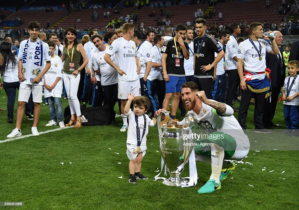 Sergio Ramos of Real Madrid poses with the trophy during the UEFA Champions League Final between Real Madrid CF and Club Atletico de Madrid at the Giuseppe Meazza of San Siro Stadium on May 28, 2016 in Milan, Italy.