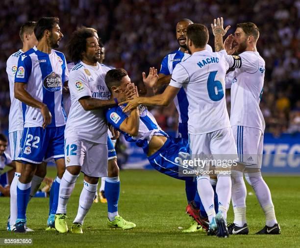 Sergio Ramos of Real Madrid pushes Fabian Schar of Deportivo de La Coruna during the La Liga match between Deportivo La Coruna and Real Madrid at...