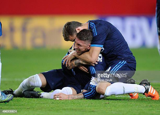 Sergio Ramos of Real Madrid reacts after getting injured while scoring his team's opening goal during the La Liga match between Sevilla FC and Real...