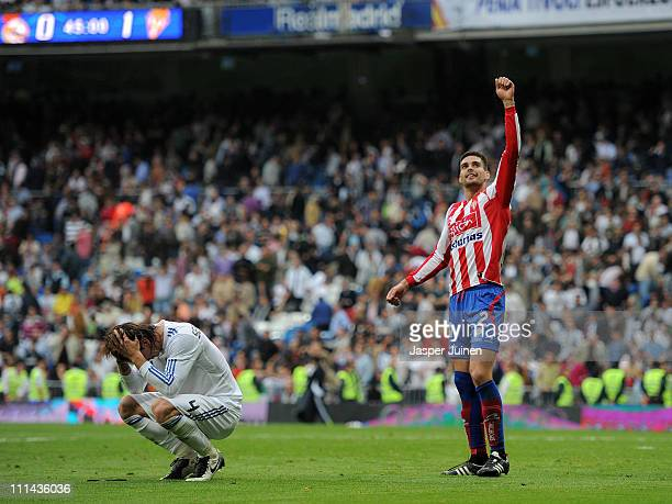 Sergio Ramos of Real Madrid reacts besides Alberto Botia of Sporting Gijon at the end of the la Liga match between Real Madrid and Sporting Gijon at...