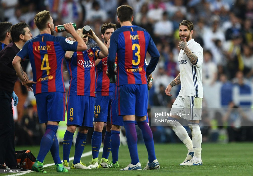 Sergio Ramos of Real Madrid (R) reacts towards Barcelona players as he is sent off during the La Liga match between Real Madrid CF and FC Barcelona at Estadio Bernabeu on April 23, 2017 in Madrid, Spain.