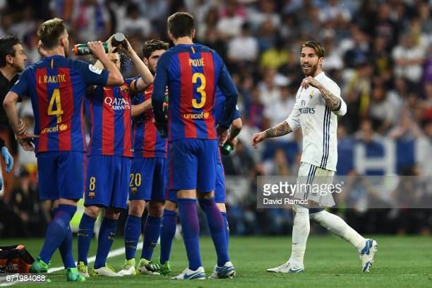Sergio Ramos of Real Madrid reacts towards Barcelona players as he is sent off during the La Liga match between Real Madrid CF and FC Barcelona at...