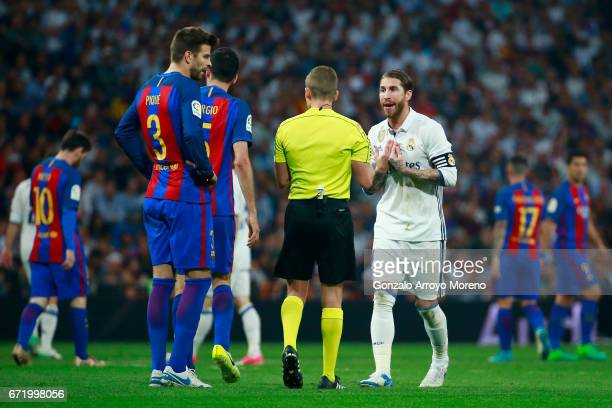Sergio Ramos of Real Madrid remonstrates with referee Alejandro Jose Hernandez Hernandez during the La Liga match between Real Madrid CF and FC...