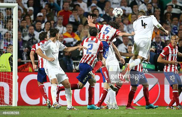 Sergio Ramos of Real Madrid scores a goal during the UEFA Champions League final between Real Madrid and Atletico de Madrid at Estadio da Luz stadium...