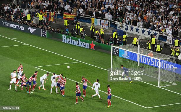 Sergio Ramos of Real Madrid scores his team's first goal during the UEFA Champions League Final between Real Madrid CF and Club Atletico de Madrid at...