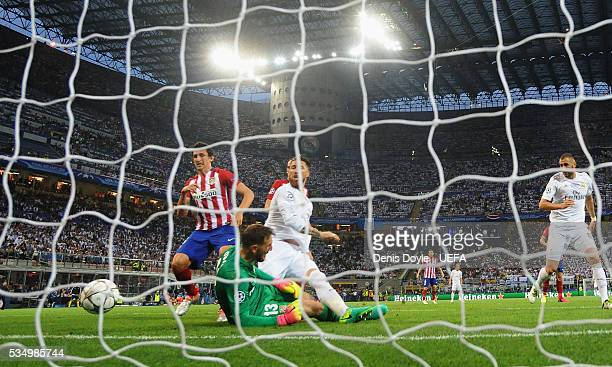 Sergio Ramos of Real Madrid scores his team's first goal past Jan Oblak of Atletico Madrid during the UEFA Champions League Final between Real Madrid...