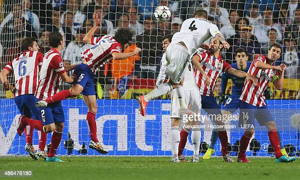 Sergio Ramos of Real Madrid scores his team's opening goal during the UEFA Champions League Final between Real Madrid CF and Club Atletico de Madrid...