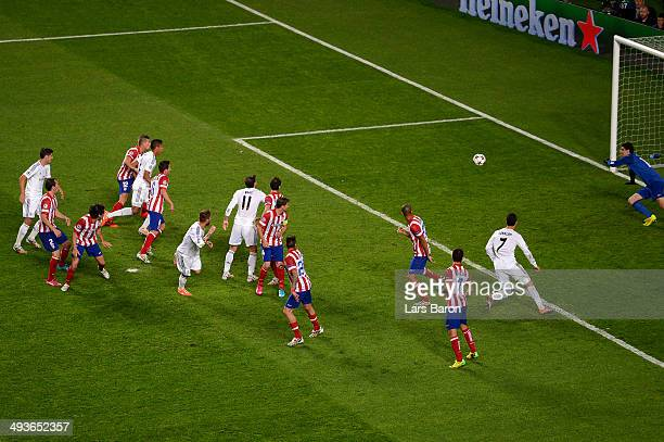 Sergio Ramos of Real Madrid scores the equalising goal during the UEFA Champions League Final between Real Madrid and Atletico de Madrid at Estadio...