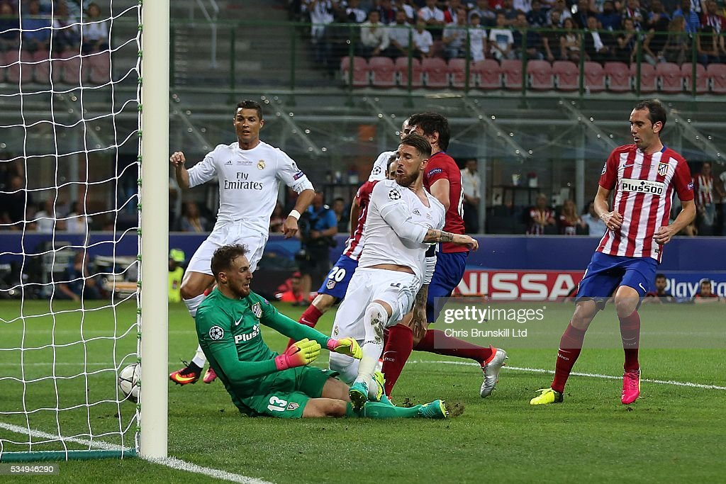 Sergio Ramos of Real Madrid scores the opening goal during the UEFA Champions League Final between Real Madrid and Club Atletico de Madrid at Stadio Giuseppe Meazza on May 28, 2016 in Milan, Italy.