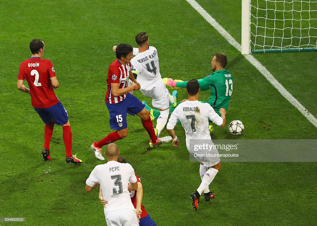Sergio Ramos of Real Madrid (c) scores the opening goal past Jan Oblak goalkeeper of Atletico Madrid during the UEFA Champions League Final match between Real Madrid and Club Atletico de Madrid at Stadio Giuseppe Meazza on May 28, 2016 in Milan, Italy.