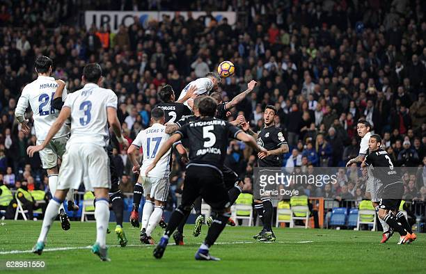 Sergio Ramos of Real Madrid scores their 3rd goal during the La Liga match between Real Madrid CF and RC Deportivo La Coruna at Estadio Santiago...