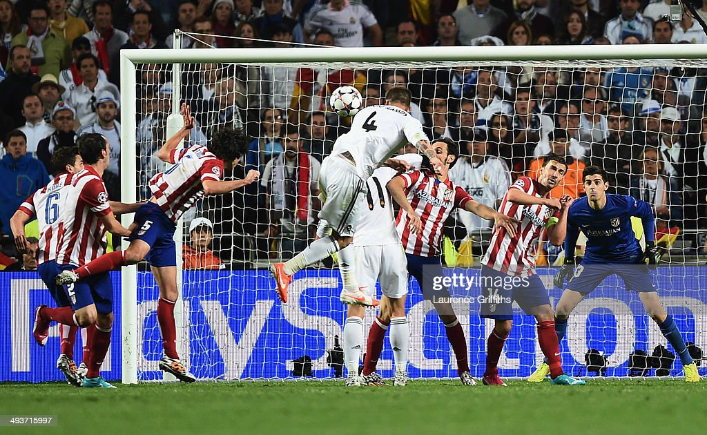 Sergio Ramos of Real Madrid scores their first goal with a header during the UEFA Champions League Final between Real Madrid and Atletico de Madrid...