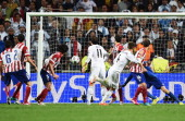 Sergio Ramos of Real Madrid scores their second goal during the UEFA Champions League Final between Real Madrid and Atletico de Madrid at Estadio da...