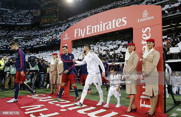 Sergio Ramos of Real Madrid shakes hands with Sergio Busquets before the La Liga match between Real Madrid CF and FC Barcelona at Estadio Santiago...