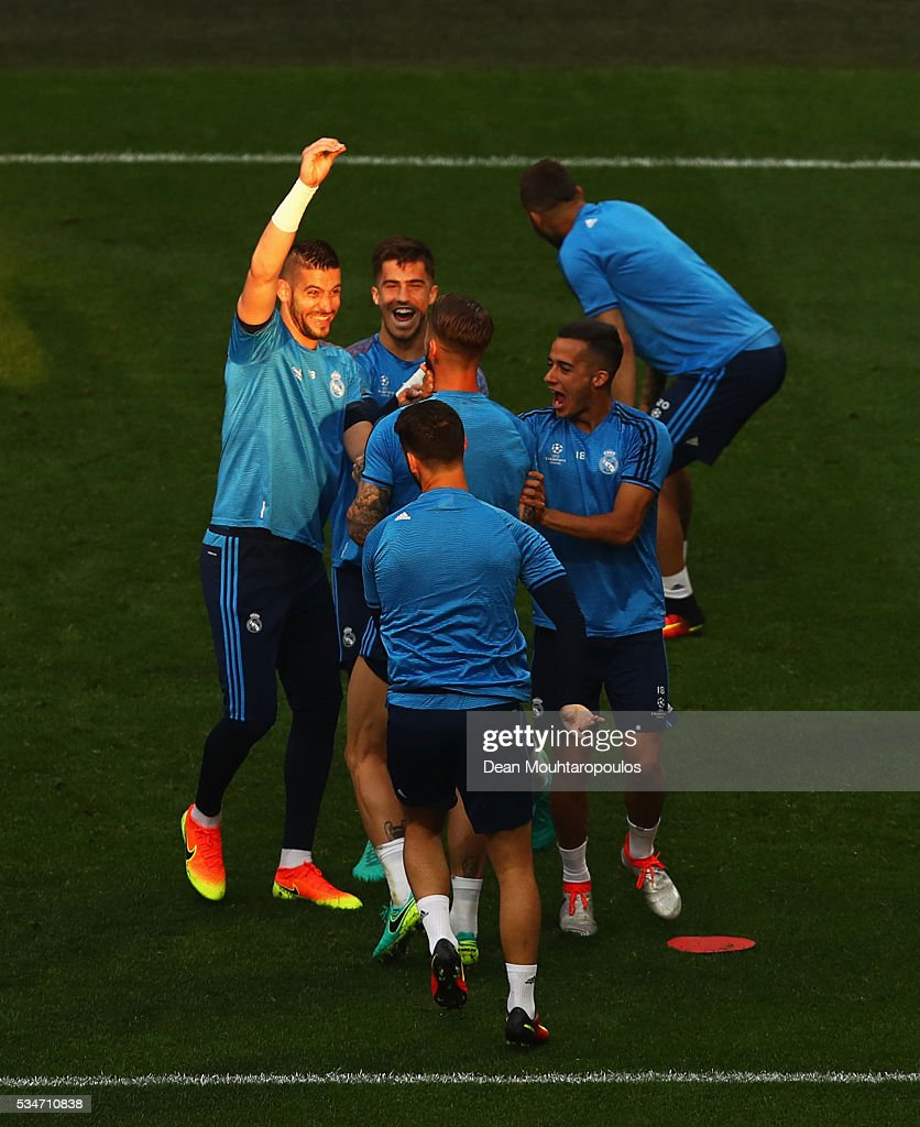 Sergio Ramos of Real Madrid shares a joke with teammates including Lucas Vazquez (r) during a Real Madrid training session on the eve of the UEFA Champions League Final against Atletico de Madrid at Stadio Giuseppe Meazza on May 27, 2016 in Milan, Italy.