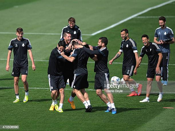 Sergio Ramos of Real Madrid shares a light moment with team mates during the Real Madrid training at Valdebebas grounds ahead of the UEFA Champions...
