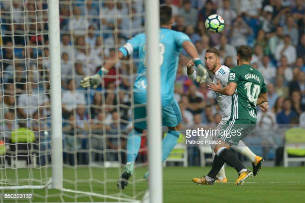 Sergio Ramos of Real Madrid struggles for the ball with Riza Durmisi of Betis during a match between Real Madrid and Betis as part of La Liga at...