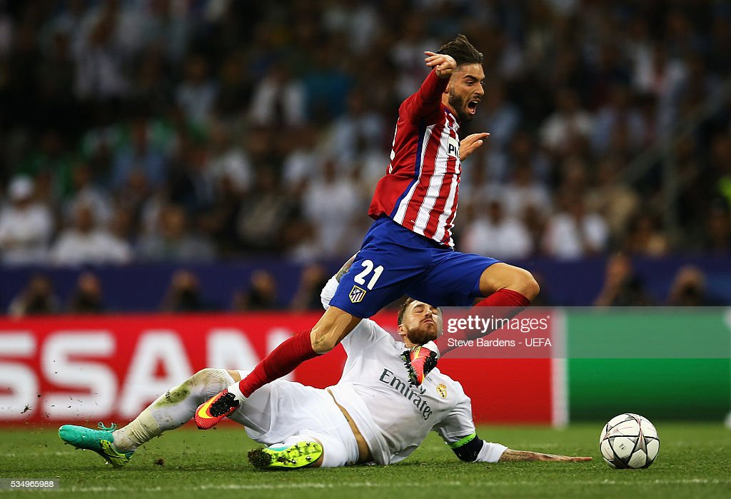 Sergio Ramos of Real Madrid tackles Yannick Carrasco of Atletico Madrid during the UEFA Champions League Final between Real Madrid and Club Atletico de Madrid at Stadio Giuseppe Meazza on May 28, 2016 in Milan, Italy..