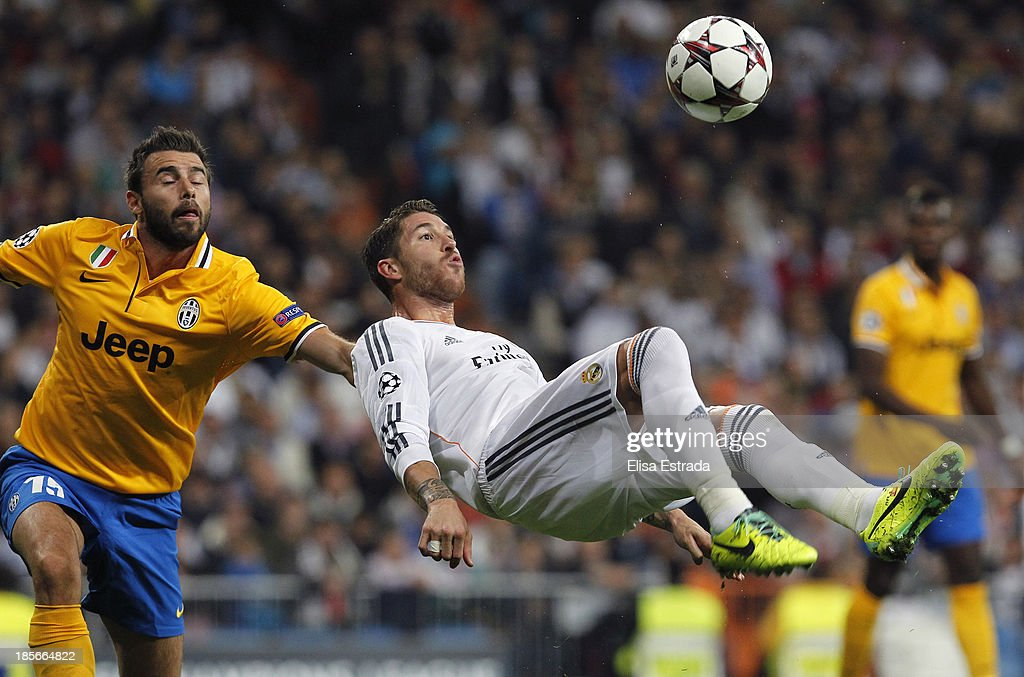 Sergio Ramos of Real Madrid takes an overhead kick beside <a gi-track='captionPersonalityLinkClicked' href=/galleries/search?phrase=Andrea+Barzagli&family=editorial&specificpeople=465353 ng-click='$event.stopPropagation()'>Andrea Barzagli</a> of Juventus during the UEFA Champions League Group B match between Real Madrid and Juventus at Estadio Santiago Bernabeu on October 23, 2013 in Madrid, Spain.