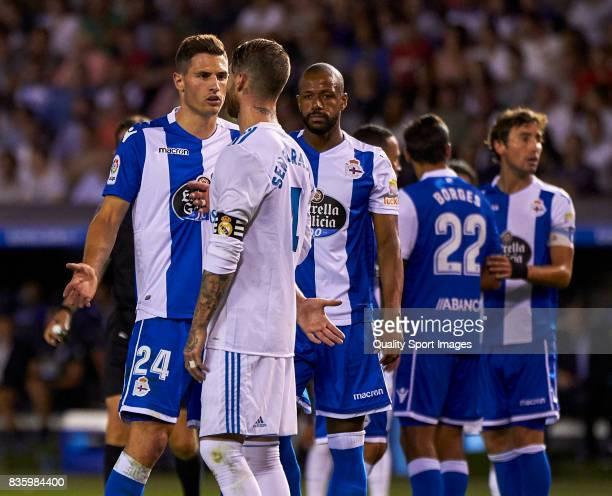 Sergio Ramos of Real Madrid talks with Fabian Schar of Deportivo de La Coruna during the La Liga match between Deportivo La Coruna and Real Madrid at...