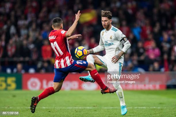 Sergio Ramos of Real Madrid vies for the ball with Angel Correa of Atletico de Madrid during the La Liga 201718 match between Atletico de Madrid and...