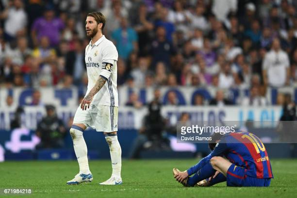 Sergio Ramos of Real Madrid walks past Lionel Messi of Barcelona as he is sent off during the La Liga match between Real Madrid CF and FC Barcelona...