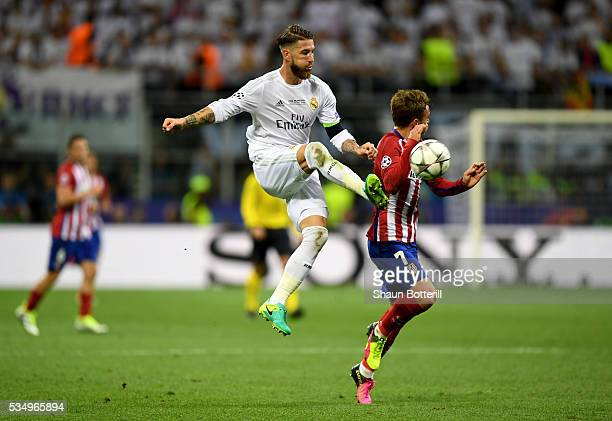 Sergio Ramos of Real Madrid wins the ball from Antoine Griezmann of Atletico Madrid during the UEFA Champions League Final match between Real Madrid...